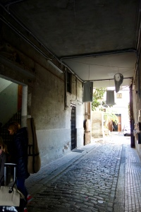 a view from the road, down the service entrance, and into the factory courtyard
